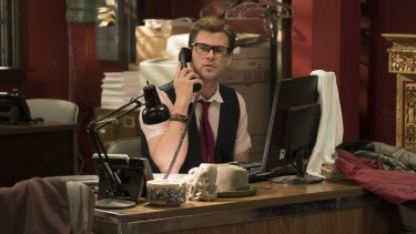 Who you gonna call? Chris Hemsworth as the team's handsome airhead receptionist Kevin.