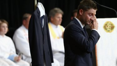 """I keep looking for him, I know it's crazy"": Michael Clarke fights through tears as he speaks at the service."