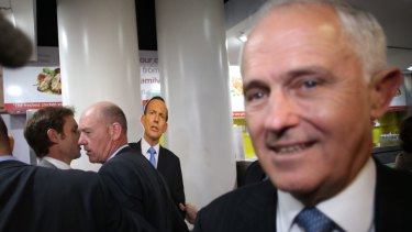 Prime Minister Malcolm Turnbull is stalked by a Tony Abbott cut-out wielded by a member of the satirical Chaser program.