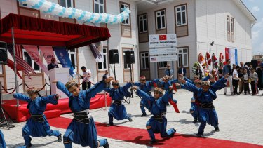 Syrian refugee children at the Sakirpasa Umran school, funded by the US government, dance during its opening ceremony in Adana, southern Turkey, in May.