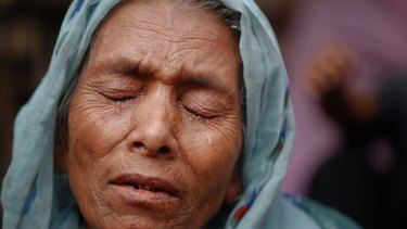 Sufia Begum, a Rohingya who recently crossed over to Bangladesh, cries on December 2 as she describes her experiences in Myanmar's Rakhine state.