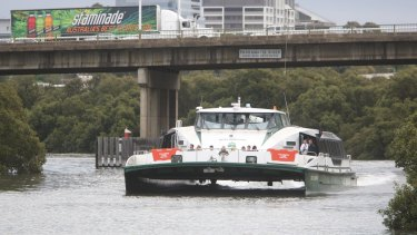 A RiverCat nears the railway and pipeline bridges at Rydalmere on the upper reaches of the Parramatta River.