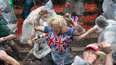 A man dressed as Boris Johnson takes part in a tomato fight at Britain's Glastonbury Festival  over the weekend.