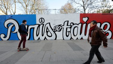 As Paris reeled from the worst attacks France has known since the end of World War II, its street artists took to city walls and billboards to paint notes of defiance. Here the words say 'Paris, I love you'.