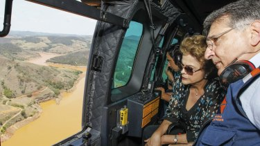 Brazilian President Dilma Rousseff, accompanied by Minas Gerais state governor Fernando Pimentel, looks out over the dam site.