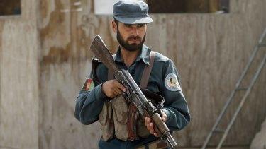 An Afghan policemanat his checkpoint in Kandahar, Afghanistan, in January.