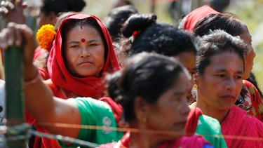 Nepalese women wait in line to cast their votes. In mountain villages and Himalayan foothill towns people hope the election will bring government closer to rural and remote areas.