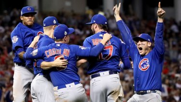 Drought-breakers: The Chicago Cubs celebrate after a marathon rain-affected decider against Cleveland.