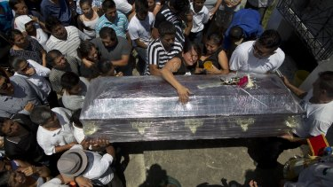 Relatives cry over the coffin of Kexly Valentino, who died with her mother Gabriela and her brother Alex in the first earthquake, in Montecristi, Ecuador.
