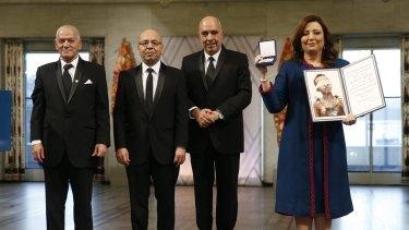 Representatives of the Tunisian National Dialogue Quartet, from left to right,  Houcine Abassi, Mohamed Fadhel Mahfoudh, Abdessattar Ben Moussa and Wided Bouchamaoui, receiving the 2015 Nobel Peace Prize in Oslo on December 10.