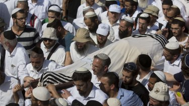 Israeli relatives and friends carry the body of Rabbi Nehemia Lavi at his funeral in Jerusalem.