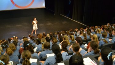 Nicole Pedersen-McKinnon presenting to high school students.