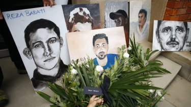 A depiction of Reza Barati, who was killed on Manus Island, and other people who died in Australian immigration detention centres are seen during a rally in front of Prime Minister Malcolm Turnbull's electoral office in Edgecliff in March 2016.