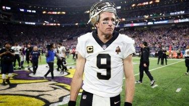 Dejected New Orleans Saints quarterback Drew Brees walks off the field.