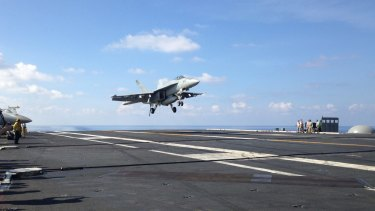 An FA-18 jet fighter lands on a US aircraft carrier in the South China Sea this month.