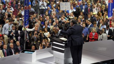 Chris Christie speaks while others chant.