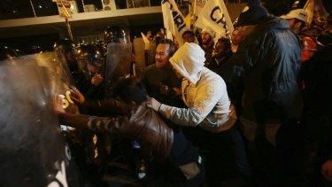 Lasso supporters clash with police near in Quito, on Sunday, as Moreno was declared the winner.