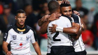 Touchdown: Fiji's Etuate Tamanikaitai Qionimacawa celebrates with teammates after scoring a try during the Test against PNG on Saturday.