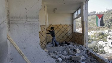 A relative of Abdel Rahman al-Shalodi inside the demolished family home in the occupied East Jerusalem neighbourhood of Silwan.