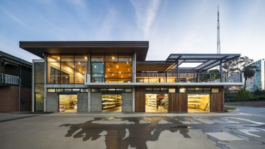The new wing echoes the form of the '70s club.