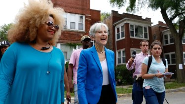 Green Party presidential candidate Jill Stein, centre, has asked for recounts, citing hacking concerns.
