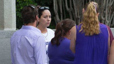 Tiahleigh Palmer's mother Cindy waits with supporters outside court earlier this week.