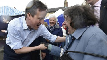 Britain's Prime Minister David Cameron greets locals during a 'walkabout' whilst campaigning in Wetherby in northern England on Thursday.
