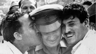 Yitzhak Rabin, centre, then Israel Defence Forces chief of staff, is greeted by jubilant Israelis after the fall of east Jerusalem to Israeli forces in June 1967.