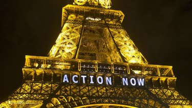 The Eiffel Tower lit up during the UN climate conference in Paris in 2015.