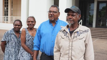 From left: Kenbi traditional owner Zoe Singh, sister Raylene Singh, NLC chairman Samuel Bush-Blanasi and traditional owner Jason Singh are all smiles outside NT Parliament House in Darwin, after the Kenbi Land Claim settlement was announced.