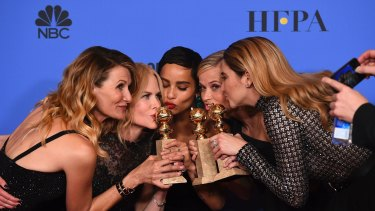 """Laura Dern, from left, Nicole Kidman, Zoe Kravitz, Reese Witherspoon and Shailene Woodley pose in the press room with the award for best television limited series or motion picture made for television for """"Big Little Lies"""" at the 75th annual Golden Globe Awards at the Beverly Hilton Hotel on Sunday, Jan. 7, 2018, in Beverly Hills, California."""