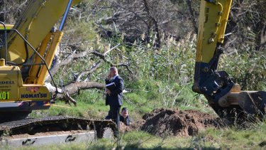 Police during the initial search on the banks of the Macquarie River, south of Dubbo, in 2012.