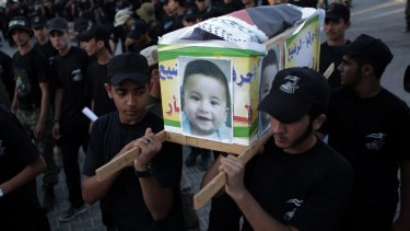 Palestinian youths carry a mock coffin of Ali Dawabshe in the Gaza Strip town of Khan Younis.