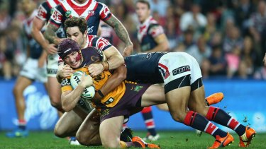 Winged: Broncos forward Matt Gillett is tackled by the Sydney Roosters defence during the top-of-the-table clash at Allianz Stadium.
