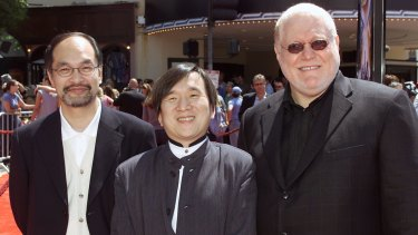 Al Kahn, right, with Pokemon creators Mr Kubo and Mr Ishihara. Kahn secured the licensing rights to the franchise for everywhere outside Asia.
