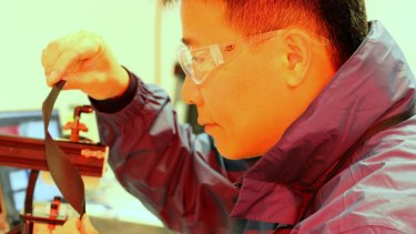 Early days: Professor Jun Chen with the new, flexible smart technology fabric.