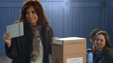 Argentinian President Cristina Fernandez de Kirchner casts her vote at a polling station in Rio Gallegos on Sunday.