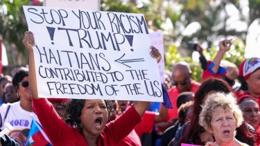 The large Haitian group said they were there to demand an apology from Trump.