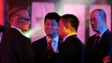 Ian Tang, centre, chairman of the 123 AustChina Education Consultancy, talks to former foreign minister and NSW premier Bob Carr, left, director of the Australia-China Relations Institute, at the dinner.