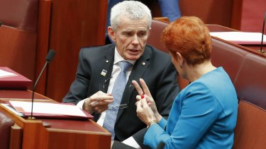 One Nation senator Malcolm Roberts and leader Pauline Hanson in discussion in the Senate.
