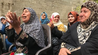 Older women sing at the Aged Care Association in Gaza, a country where many women face domestic abuse or economic uncertainty.