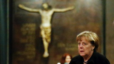 German Chancellor Angela Merkel arrives to sign the condolence book at the Kaiser Wilhelm Memorial Church in Berlin.