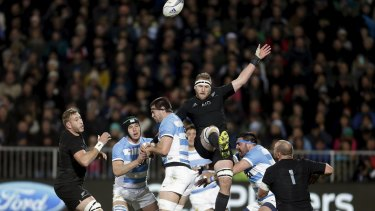 Kieran Read of New Zealand's All Blacks contests the ball with Argentina's Manuel Carizza during their Rugby Championship match at AMI Stadium in Christchurch.