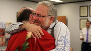 Christopher Brown and Tom Fennell hug after getting their marriage license in Omaha, Nebraska.