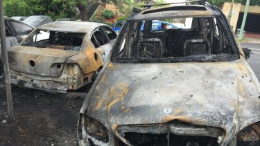 Two of the cars destroyed by fire at Bellevue Hill on Birriga Road.