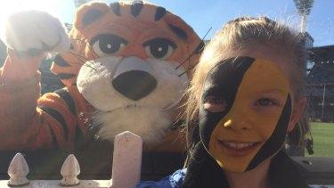 Roar talent: Annie and the Richmond mascot show their stripes.