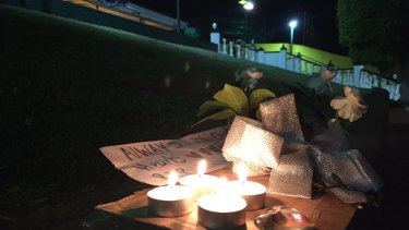 A tribute left outside Dreamworld's front gate on Tuesday night.