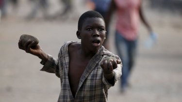 A boy at a protest on Tuesday against Burundi President Pierre Nkurunziza