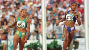 Australian runner Cathy Freeman in action against French runner Jose-Marie Perec at the Atlanta Olympics, where she won silver in the 400m.