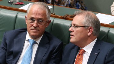 Curiouser and curiouser: Prime Minister Malcolm Turnbull and Treasurer Scott Morrison.